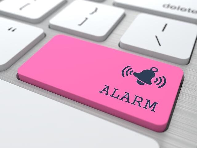 Security Concept - The Red Alarm Button on Modern Computer Keyboard. 3D Render..jpeg
