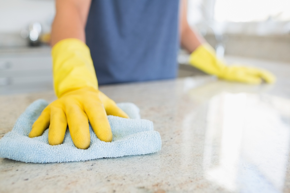 Woman cleaning the counter  in the kitchen.jpeg