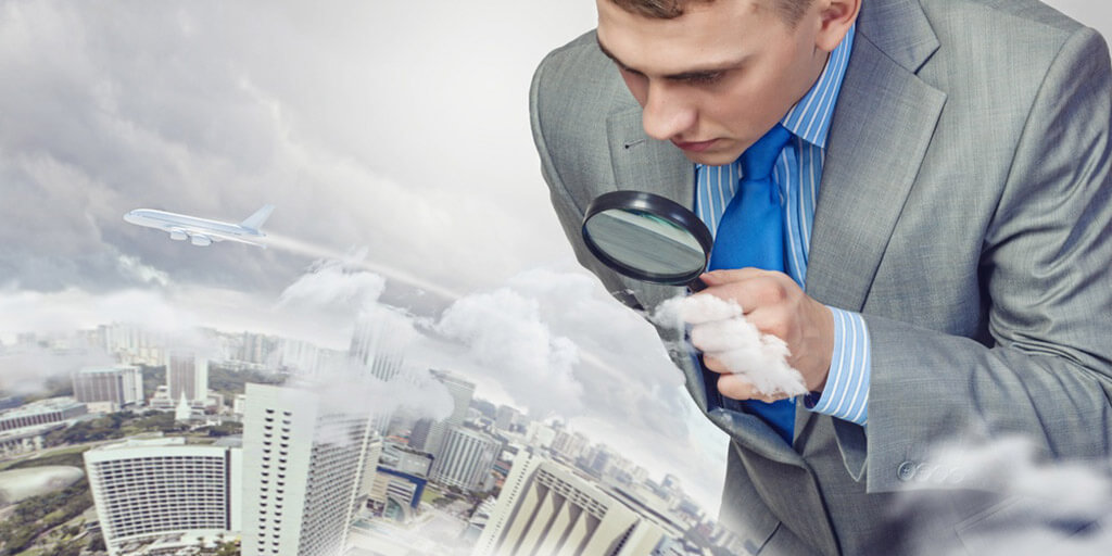 Image of businessman examining objects with magnifier.jpeg